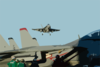 An F/a-18c Hornet Flies Over The Flight Deck Of Uss George Washington (cvn 73) Clip Art