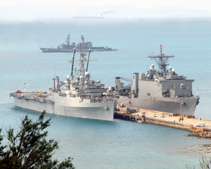 The Amphibious Transport Dock Ship U.s.s. Juneau (lpd-10) And The Amphibious Dock Landing Ship U.s.s. Fort Mc Henry (lsd 43) Are Pier Side In Okinawa, Japan Image