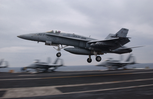 An F/a 18  Hornet  Assigned To The  Ragin Bulls  Of Strike Fighter Squadron Three Seven (vfa-37), Performs A  Touch And Go  On The Ship S Flight Deck. Image