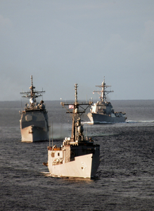 He Guided Missile Frigate Uss Ford (ffg 54), Guided Missile Cruiser Uss Lake Champlain (cg 57) And Guided Missile Destroyer Uss Howard (ddg 83) Maneuver To Establish A Multi-ship Column Formation Image