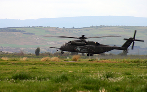 An Mh-53e Sea Dragon Assigned To The Black Stallions Of Helicopter Combat Support Squadron Four (hc-4) Attempts A Landing On Naval Air Station Sigonella Flight Line Image