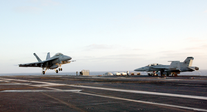 An F/a-18f  Super Hornet  Lands On Deck. Image