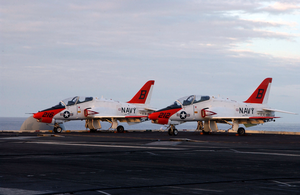 Two T-45c Goshawks Assigned To Training Air Wing Two Sit Chocked And Chained On The Flight Deck Aboard Uss Harry S Truman (cvn 75) While Awaiting Nighttime Carrier Qualifications To Commence. Image