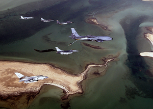 Aircraft Of The 379th Air Expeditionary Wing And Coalition Counterparts Stationed Together In A Deployed Location In Southwest Asia Fly Over The Desert Image
