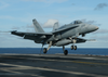 An F/a-18c Hornet Lands On The Flight Deck Image