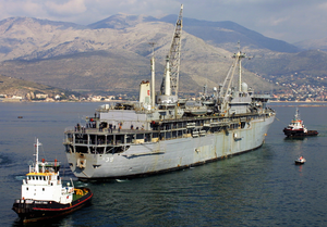 With The Help Of Tugboats, The Submarine Tender, Uss Emory S. Land (as-39), Is Maneuvered Into Place Alongside The Command Ship, Uss La Salle (agf 3). Image