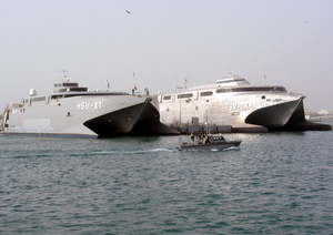 Sealift Vehicles Belonging To The U.s. Navy And U.s. Army Sit Together Pier Side Under The Watchful Eye Of Both The U.s. And Kuwaiti Harbor Patrol. Image