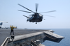 An Mh-53e Sea Dragon Helicopter Leave The Flight Deck Aboard Cv 67. Image