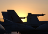 The Sun Rises Over One Of The F/a-18c Hornet Squadrons Deployed Aboard The Uss Theodore Roosevelt (cvn 71). Image