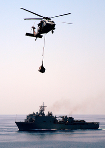 A Mh-60s Knighthawk Assigned To The  Chargers  Of Helicopter Combat Support Squadron Six (hc-6) Delivers One Of Many Palettes Of Supplies To The Amphibious Assault Ship Uss Wasp (lhd 1). Image