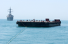 A Tug Pulling Oil Barges Suspected Of Smuggling Illegal Oil Out Of Iraq Is Followed By Uss Hopper. Image