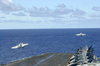 Two F/a-18e Super Hornets Assigned To The Tophatters Of Strike Fighter Squadron Fourteen (vfa-14) Launch From The Flight Deck Of Uss Nimitz (cvn 68) Image