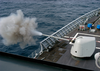 A 54 Caliber (mk 45) 5-inch Lightweight Gun Is Fired Aboard The Guided Missile Cruiser Uss Leyte Gulf (cg 55) As Part Of A Live Fire Exercise Image