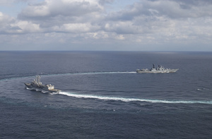Uss Vandegrift And Russian Destroyer Marshal Shaposhnikov (dd 543) Maneuver In Formation During A Russian Passing Exercise (passex) As A Joint Foreign Naval Exercise. Image