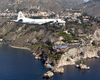 A P-3c Orion Aircraft Assigned To The Tigers Of Patrol Squadron Eight (vp-8) Flies Along The Coastline Of Taormina, Sicily. Image