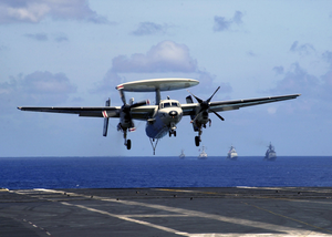 An E-2c Hawkeye Assigned To The  Sunkings  Of Carrier Airborne Early Warning Squadron One One Six (vaw-116) Comes In For A Recovery Aboard The Aircraft Carrier Uss Constellation (cv 64) With One Engine After Having An In-flight Emergency. Image