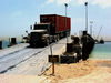 A U.s. Army Transport Vehicle Returns From The U.s. Navy Elevated Causeway System-modular Image