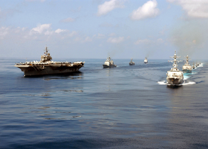 Constellation Steams Through The Ocean With Ships In Its Battle Group Image