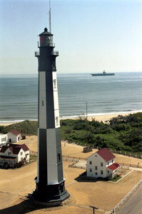 Cvn 71 Passes Lighthouse Image