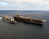 The Nuclear Powered Aircraft Carrier Uss John C. Stennis (cvn 74) Performs An Underway Replenishment (unrep) With The Fast Combat Support Ship Uss Sacramento (aoe 1). Image