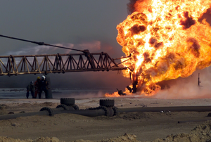 Firefighters Fight An Oil Blaze In Gas-oil Separation Plant Six As Part Of Their Ongoing Support Of Operation Iraqi Freedom. Image
