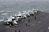 F/a-18  Hornet  And  Super Hornet  Strike Fighters Stand Ready On The Ship S Forward Flight Deck. Image