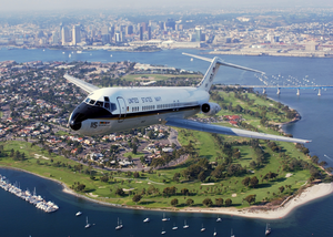 With The San Diego Skyline In The Background, A C-9b Skytrain Ii From The Conquistadors Of Fleet Logistics Squadron Fifty Seven (vr-57) Flies Over Coronado, California Image