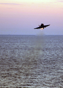 An F/a-18 Hornet Launches From The Flight Deck Aboard The Aircraft Carrier Uss Harry S. Truman (cvn 75) Image