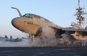 An Ea-6b Prowler Assigned To The Gauntlets Of Electronic Attack Squadron One Three Six (vaq-136) Stands Ready On One Of Two Steam Catapults On The Bow Image
