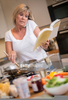 Busy Woman Cooking Image
