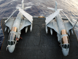Two Ea-6b Prowlers Are Transported By Aircraft Elevator From The Hangar Bay To The Flight Deck Aboard Uss John C. Stennis (cvn 74) Image