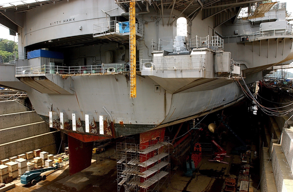 uss kitty hawk  cv 63  sits in dry dock undergoing repairs