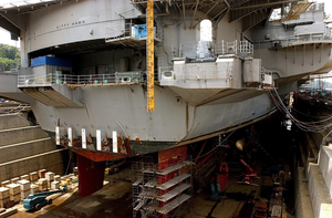 Uss Kitty Hawk (cv 63) Sits In Dry Dock Undergoing Repairs At Naval Base Yokosuka Ensuring Its Ability, To Continue To Maintain A Responsible Defensive Posture In The Western Pacific Region Image