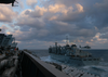 He Nuclear Powered Aircraft Carrier, Uss George Washington (cvn 73) Approaches The Military Sealift Command (msc) Fast Combat Support Ship Usns Supply (t-aoe 6) During An Early Morning Underway Replenishment. Image