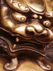 Closeup Of Brass Chinese Lion Statue Image