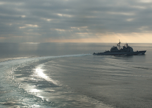 The Guided Missile Cruiser Uss Vella Gulf (cg 72) Maneuvers After A Refueling At Sea (ras). Image