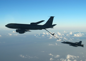An F/a-18 Hornet Assigned To The Marauders Of Strike Fighter Squadron Eight Two (vfa-82) Refuels With An U.s. Air Force Kc- 135r Fuel Tanker. Image