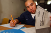 Us Navy N P Seaman Chanthorn Peou Of San Diego Calif Takes His Scholastic Aptitude Test Sat Aboard The Conventionally Powered Aircraft Carrier Uss Kitty Hawk Cv Image