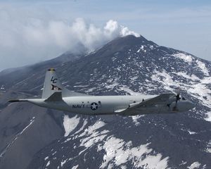 A P-3c Orion Aircraft Assigned To The  Tigers  Of Patrol Squadron Eight (vp-8) Flies Over Mt. Etna. Image