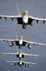 F/a-18 Super Hornets Assigned To The Black Aces Of Strike Fighter Squadron Forty One (vfa-41) Fly Over The Western Pacific Ocean Image