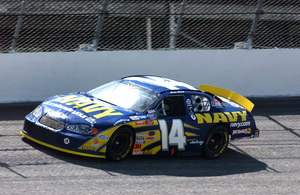 The Navy Sponsored Nascar Busch Series No. 14 Chevrolet Monte Carlo, Driven By Casey Atwood Races For The Finish Line To Place In The Top Ten Of The Winn-dixie 200 Race Image