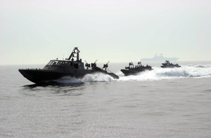 Naval Special Warfare Combatant-craft Crewmen Operate Rigid Hull Inflatable Boats (rhib) And Mark V Special Operations Craft From A Forward Operating Location. Image