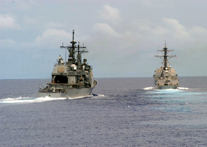 The Guided Missile Cruiser Uss Antietam (cg 54) Approaches The Port Side Of The Guided Missile Frigate Uss Ingraham (ffg 61) During A Leap Frog Training Exercise Image