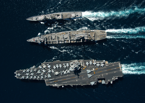 The Guided Missile Cruiser Uss Gettysburg (cg 64), Top, And The Aircraft Carrier Uss Enterprise (cvn 65), Bottom, Underway Alongside The Fast Combat Support Ship Uss Detroit (aoe 6) . Image