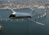 A C-9b Skytrain Ii From The Conquistadors Of Fleet Logistics Squadron Fifty Seven (vr-57) Passes By The Coronado Bay Bridge Image