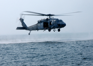 Search And Rescue Swimmers Assigned To The Chargers Of Helicopter Combat Support Squadron Six (hc-6) Stand Ready Aboard An Mh-60s Knighthawk Image