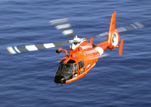 Coast Guard Hh-65a Rescue Helicopter Performs A Homeland Security Flight Over The Waters Of Near Oahu, Hawaii Image