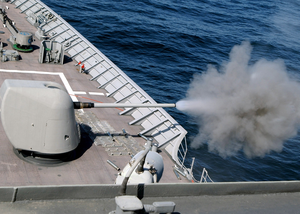 A Cloud Of Propellant-gas Discharge Is Expelled From The 5-inch Gun Aboard The Aegis Cruiser Uss Vella Gulf (cg 72) Image
