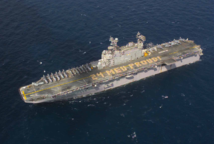 Arines Assigned To The 24th Marine Expeditionary Unit (meu) Embarked Aboard The Amphibious Assault Ship Uss Nassau (lha 4), Create Formation Lettering On The Ship S Flight Deck Spelling Out 24 Meu Proud! Image