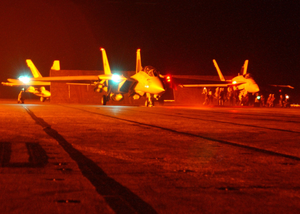 An F-14 Tomcat (center) Prepares To Launch From The Flight Deck Aboard Uss Theodore Roosevelt (cvn 71), As An F/a-18 Hornet (right) Prepares To Launch Image